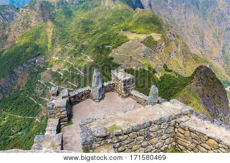MACHU PICCHU CUZCO PERU - AUGUST 21 2013: Misterious city in South America. The Incan ruins and terrace. Example of polygonal masonry and skill in Machu picchu.