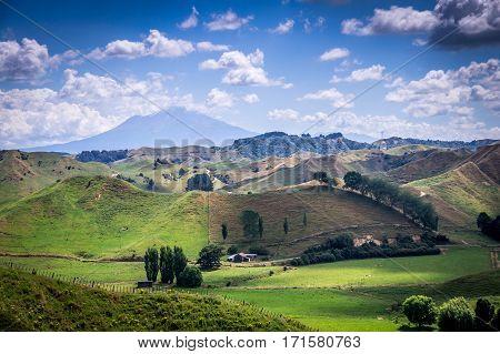 View on Ngauruhoe Volcano with beautiful green hills, near Tongariro National Park, North Island, New Zealand