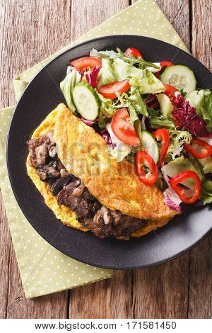 Austrian Cutlet With Mushrooms, Scrambled Eggs And Vegetable Salad Close-up. Vertical Top View