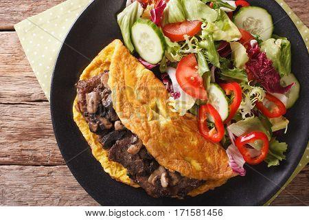 Austrian Cuisine: Imperial Cutlet With Mushrooms, Scrambled Eggs And Salad Closeup. Horizontal Top V