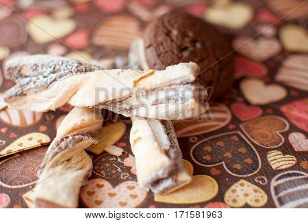 Cookies on dark napkin with image of hearts close up. Selective focus.