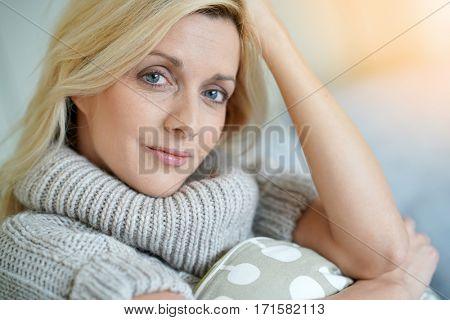 Portrait of attractive blond woman wearing turtleneck