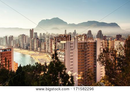 Aerial View from mountain of the city of Benidorm Spain taken in the early morning when the city is covered with fog