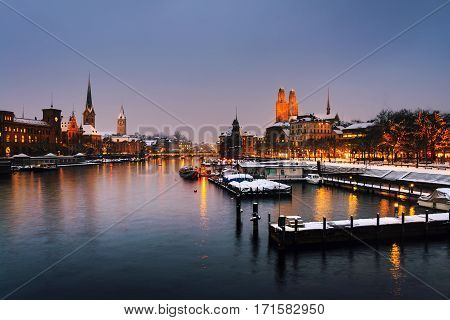 Zurich Switzerland old town situated on the Limmat river. Illuminated building in Zurich Switzerland - the largest city in the country