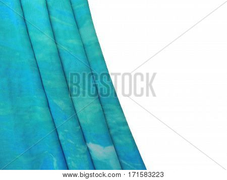 Turquoise blue textile folds on white background with empty space.