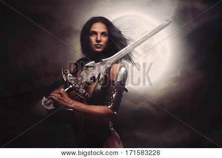 Sexy Warrior fantasy Woman with Moon in night