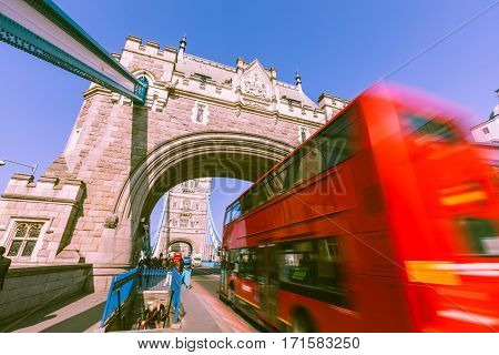 Blurred Red Bus On Tower Bridge In London