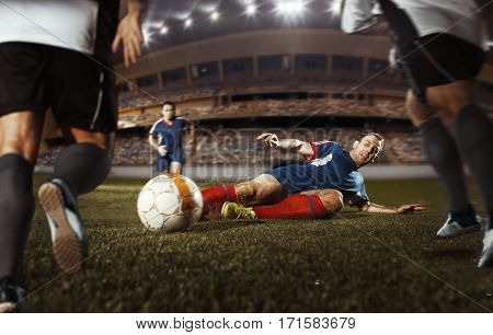 The Football In The Fall Kicks The Ball In The Game At The Stadium