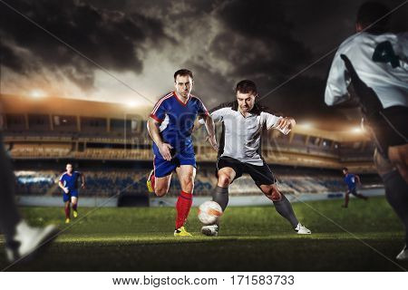 The Football Player Kicks The Ball In The Game At The Stadium