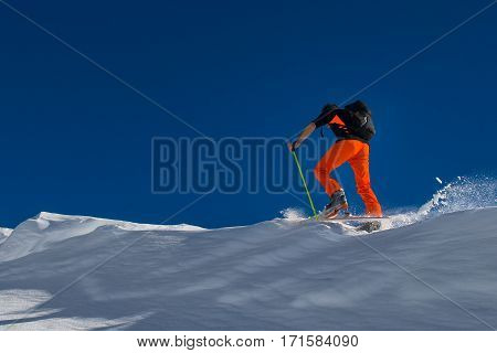 A Man Alpine Skier Climb On Skis And Sealskins