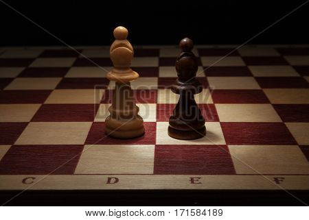 Wooden chess. Black and White Bishop on chess board.