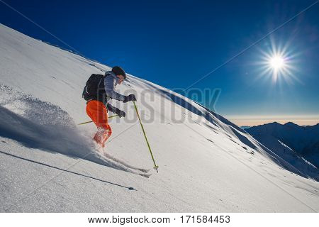 Backcountry Skier In Fresh Snow