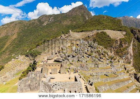 MACHU PICCHU CUZCO, PERU - AUGUST 21 2013: Misterious city in South America. The Incan ruins and terrace. Example of polygonal masonry and skill in Machu picchu.