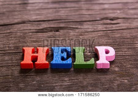 help word made from colored wooden letters on an old table. Concept