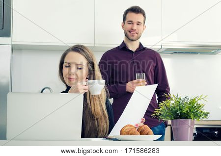 Young Businesswoman Working At Home Drinking Coffee