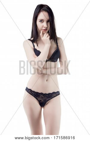 Flirting young woman in lingerie on white background