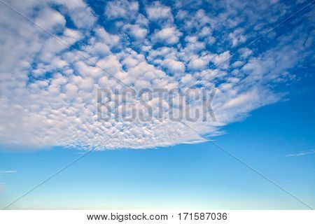 Fancy flying clouds in blue sky. Heavenly background in a highly patterned top. Free space atmospheric flight and freedom.