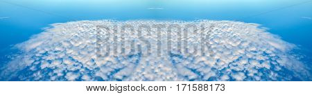 Fancy figar of flying clouds in the blue sky. Heavenly background in a highly patterned top. Free space atmospheric flight and freedom.