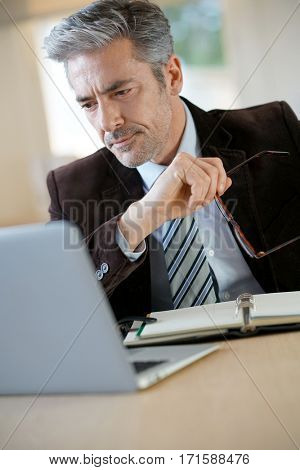 Attorney working in office on laptop
