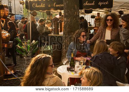 PARIS, FRANCE - OCTOBER 11, 2015: People celebrating festival of the grape harvest on Montmartre hill.