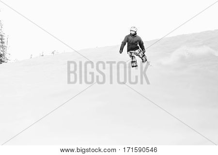 Black And White Picture Of Man Going Dow The Hill On His Snowboard