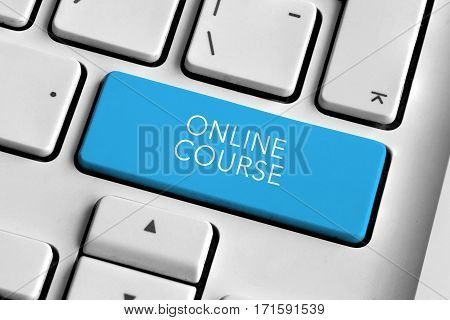 White keyboard with blue online course button