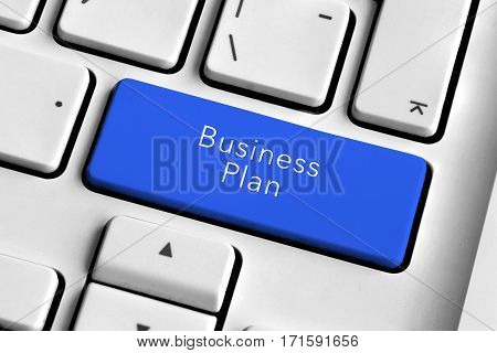 White keyboard with blue business plan button