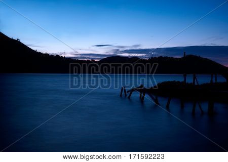 Wharf on a lake early in the morning.