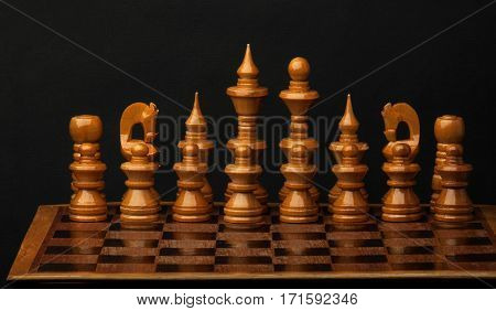 White chess figures on wood board. Set of chess figures.
