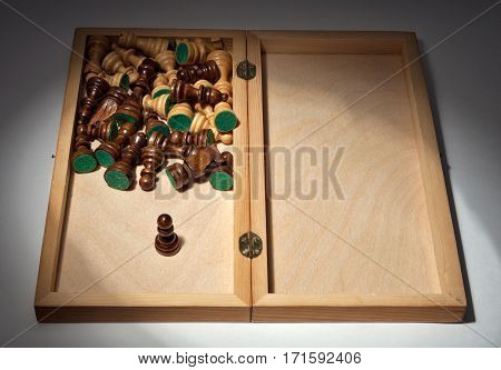 Chess. The idea - a hero. Chess pieces in a wooden box inside.