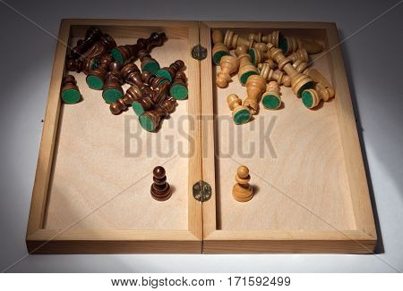 Chess. The idea - face to face. Chess pieces in a wooden box inside.