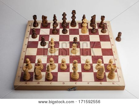 Scholar's mate. Chess Game on Wooden Board. White side.