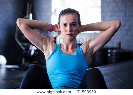 Portrait of serious female athlete exercising in gym