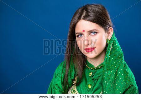 Close up portrait of beautiful eastern woman in green sari