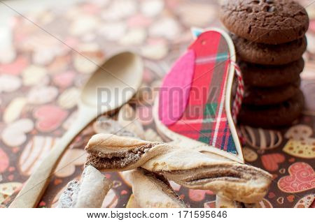 Red Toy Bird And Cookies On Dark Napkin With Image Of Hearts