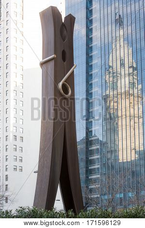 Famous Clothpin sculpture by Claes Oldenburg and reflection of Philadelphia City Hall on August 2, 2009. Sculpture located on Centre Square.