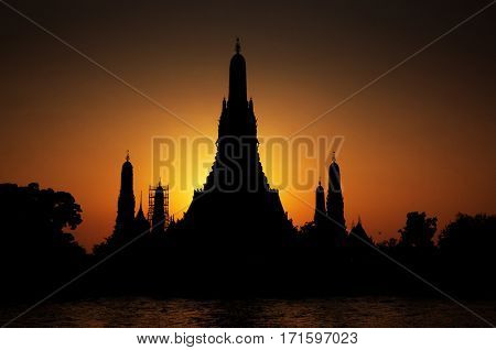 silhouette of Wat Arun at sunset seen from Chao Phraya river,Bangkok,Thailand