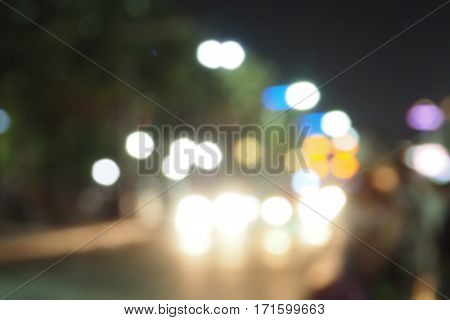 Car lamp lighting blur in Pattaya street road in the night times are circle shape lighting at Pattaya Thailand trip.