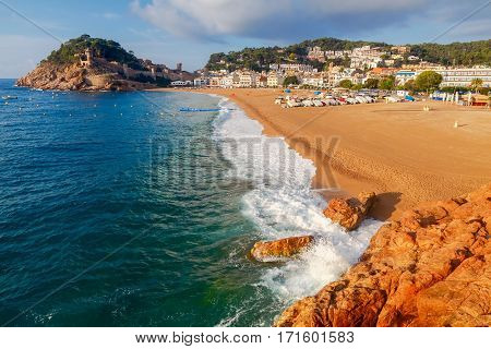 Sandy beach at Tossa de Mar in the early morning in September.
