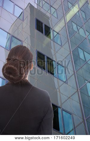 Young businesswoman looking at a office building