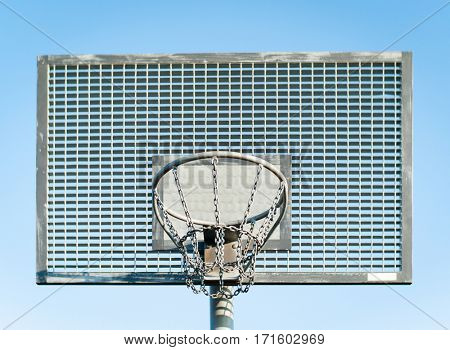 Basketball hoop in front of blue sky