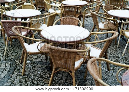 Bistro tables covered with snow
