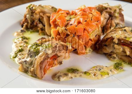 Roasted Rabbit Roulade with Carrot and sauce.