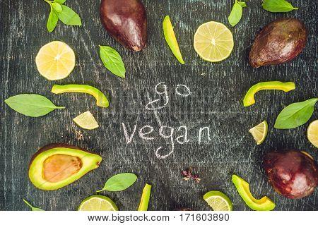 Go Vegan Concept With Lettering. Variety Of Fresh Green Organic Vegetables Lentils On Dark Backgroun