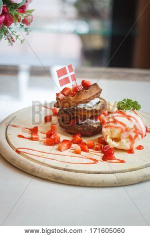 Waffles With Fruit and Maple Syrup on a Marble Counterin Thailand
