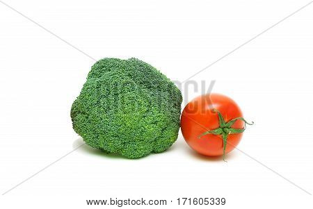 broccoli and cherry tomatoes on a white background close-up. horizontal photo.