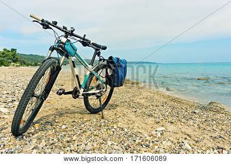 Parked on the beach mountain bike waiting for the continuation of travel.
