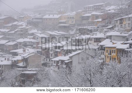 VELIKO TARNOVO BULGARIA - JANUARY 6 2017: Closeup view of the town in blizzard on the winter day