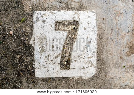 The Digits With Concrete On The Sidewalk 7