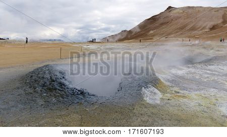 A steaming fumarole on the  geo-thermal heated Krafla Landscape in Iceland